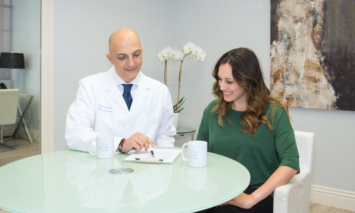 Dr. Nathan Newman reviews a treatment plan with a patient.